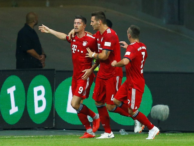 Robert Lewandowski celebrates scoring the second during the German Super Cup game between Eintracht Frankfurt and Bayern Munich on August 12, 2018