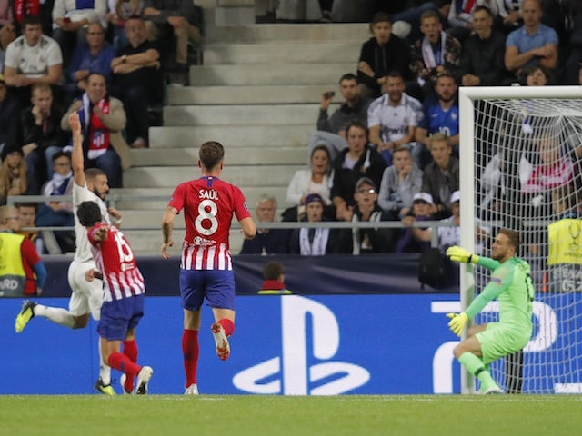 Real Madrid striker Karim Benzema scores the equaliser during his side's UEFA Super Cup clash with Atletico Madrid on August 15, 2018