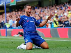 Eden Hazard celebrates getting his side's first during the Premier League game between Chelsea and Cardiff City on September 15, 2018