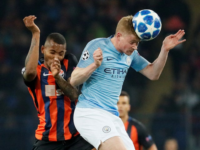Kevin De Bruyne and Fernando in action during the Champions League group game between Shakhtar Donetsk and Manchester City on October 23, 2018