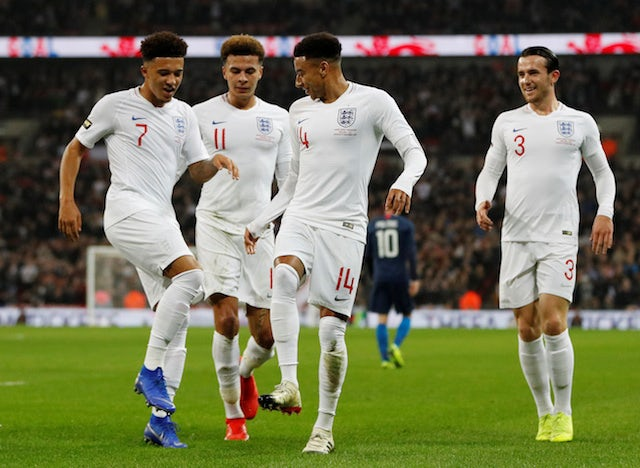 England's Jesse Lingard celebrates scoring with Jadon Sancho, Dele Alli and Ben Chilwell against the USA