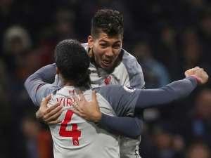 Roberto Firmino celebrates scoring with Liverpool teammate Virgil van Dijk on December 5, 2018