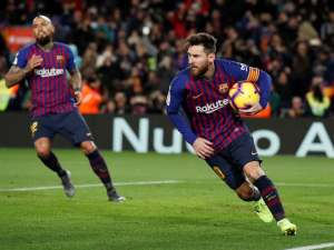 The Barcelona striker Lionel Messi grabs the ball after scoring against Valencia in the Liga on February 2, 2019