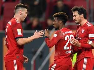 Bayern Munich players celebrate Kingsley Coman's goal against Augsbury on 15 February 2019