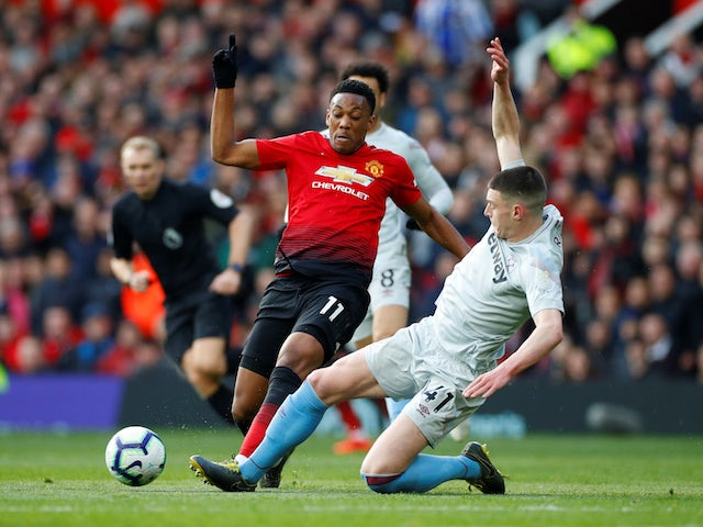 Manchester United's Anthony Martial in action with West Ham United's Declan Rice in the Premier League on April 13, 2019