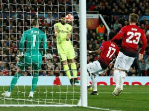 Luis Suarez scores Barcelona's opener against Manchester United in the Champions League on April 10, 2019