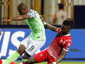 Burundi's Gael Bigirimana challenges Nigeria's Odion Ighalo at the 2019 Africa Cup of Nations