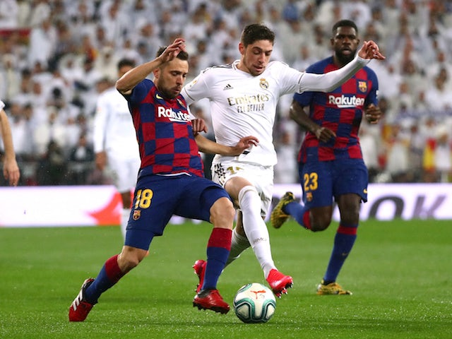 Real Madrid midfielder Federico Valverde in action with Barcelona's Jordi Alba on March 1, 2020