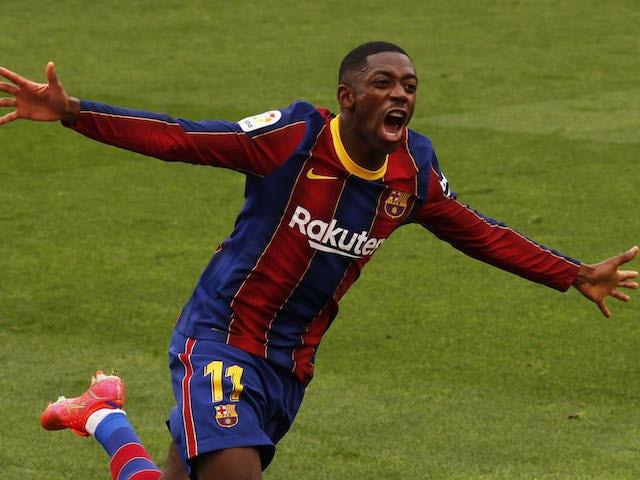 Barcelona's Ousmane Dembele celebrates scoring their first goal on February 27, 2021