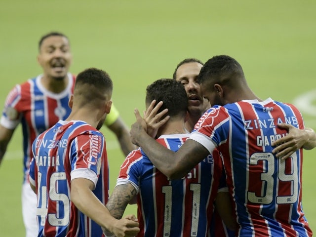 Bahia's Rossi celebrates scoring their first goal with teammates on February 13, 2021