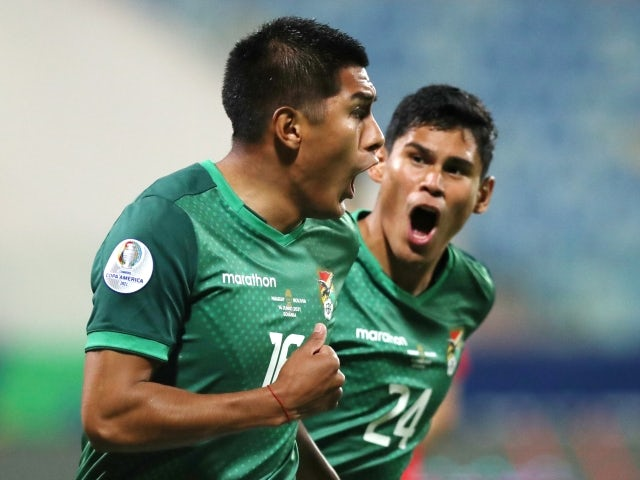Bolivia's Erwin Saavedra celebrates scoring their first goal with Jaume on June 15, 2021