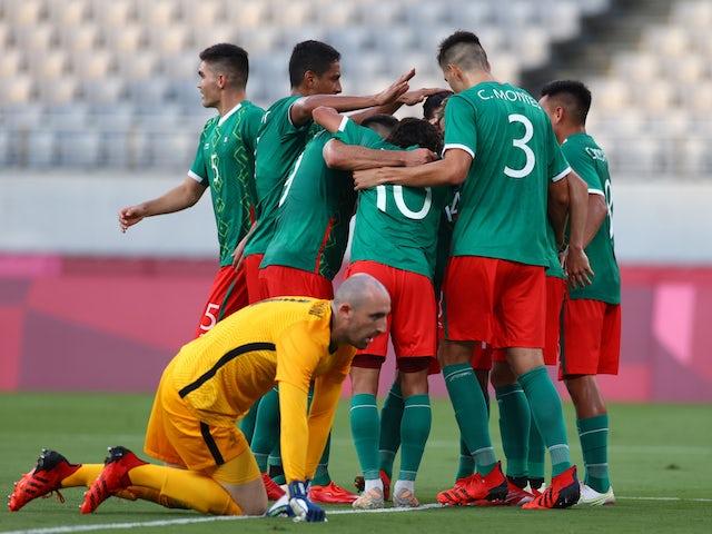 Sebastian Cordova of Mexico celebrates scoring their second goal with teammates as Paul Bernardoni of France looks dejected on July 22, 2021