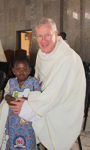 Fr-Corrigan-with-Child-afte