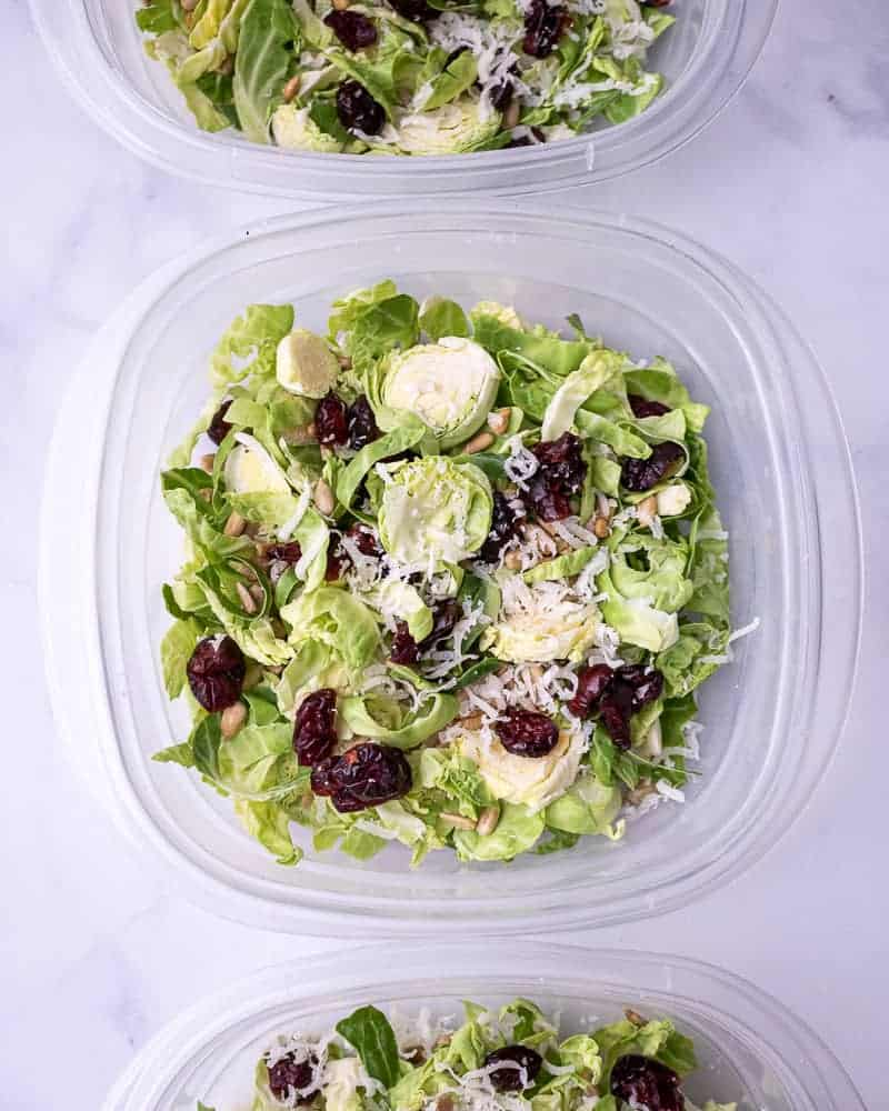 A food storage bowl with salad inside.