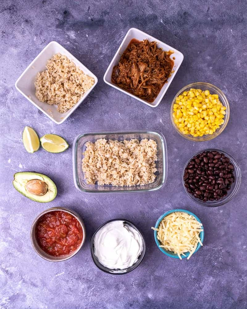 Step one of building the burrito bowl is rice.