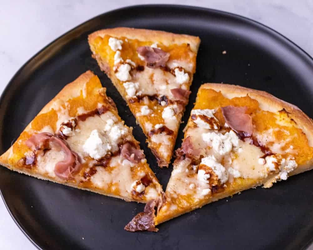 Up close slices of mashed butternut squash pizza