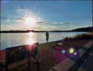 Sun flares around Man Fishing