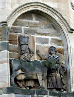 The story of the Dun Cow, as depicted in an eighteenth-century panel on the north facade of Durham Cathedral.