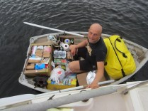 Rowing all the food back to the boat.