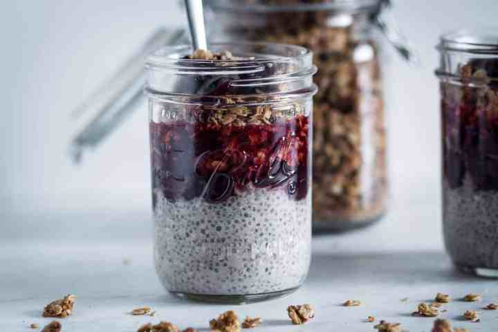 a jar of gluten free chia pudding breakfast parfait ready to eat