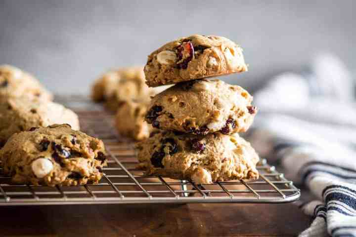 stack of three soft and chewy gluten free white chocolate chip cranberry cookies