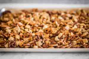 air fryer chex mix on a baking sheet for gluten free game day snacks