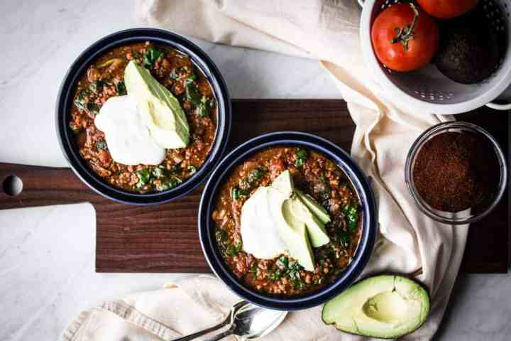 two bowls of gluten free instant pot taco soup with sour cream and avocado