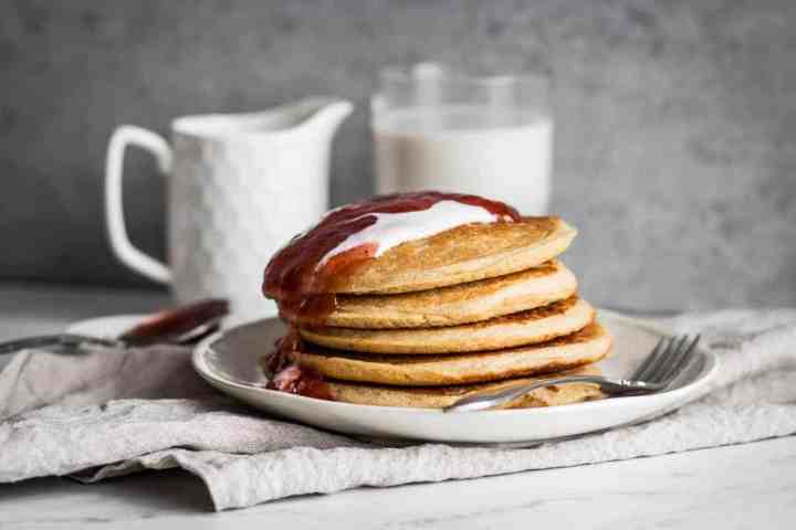 stack of gluten free buttermilk pancakes with strawberry jam