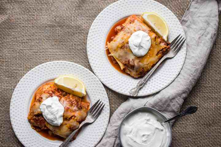 two plates of gluten free skillet enchiladas with homemade sauce