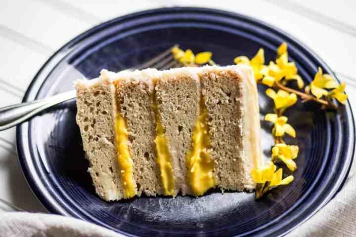 slice of easy gluten free white cake with gluten free lemon curd filling