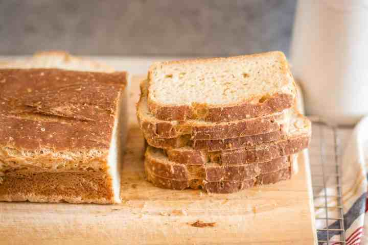 gluten free sourdough bread sliced on a cutting board