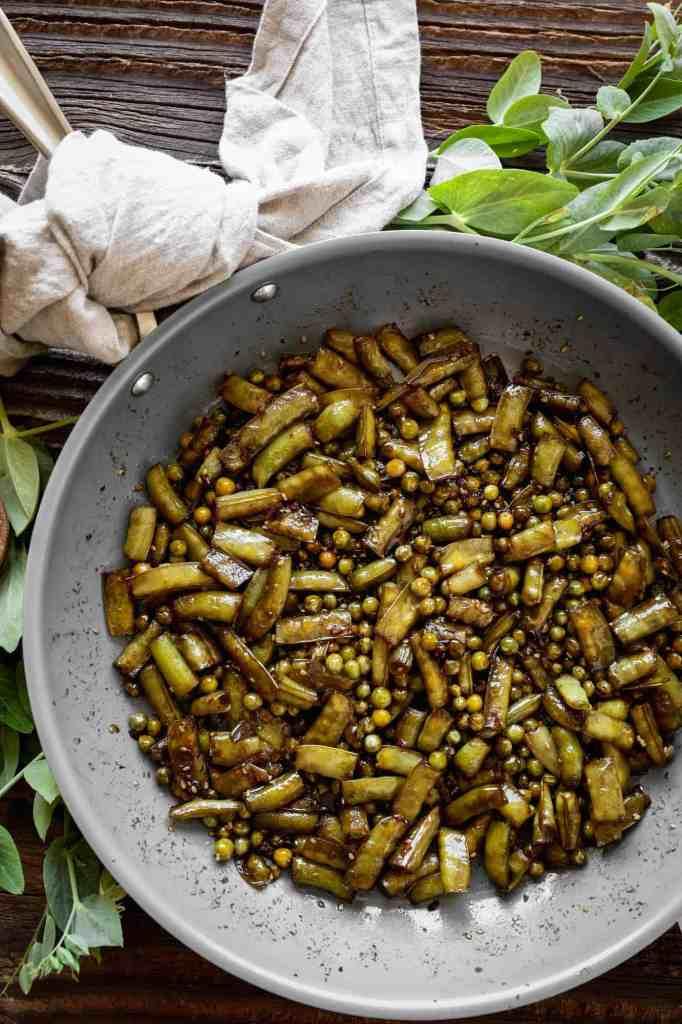 a frying pan of stir fried sugar snap peas