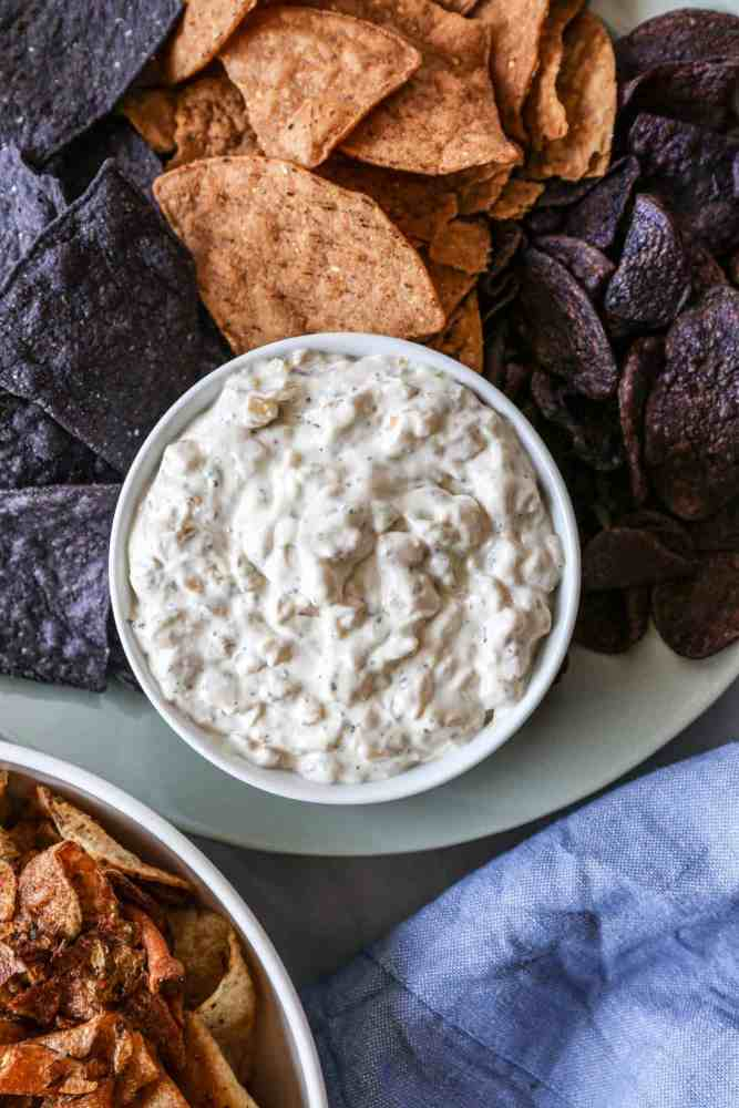 bowl of gluten free caramelized onion dip surrounded by chips