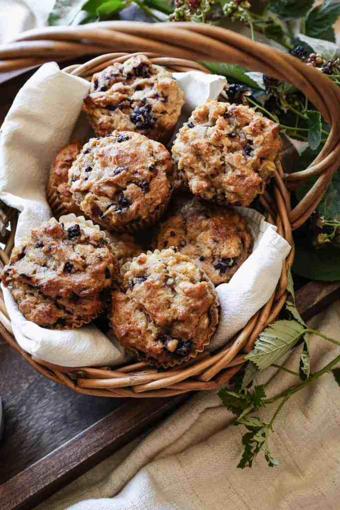 a basket of gluten free blackberry oat muffins