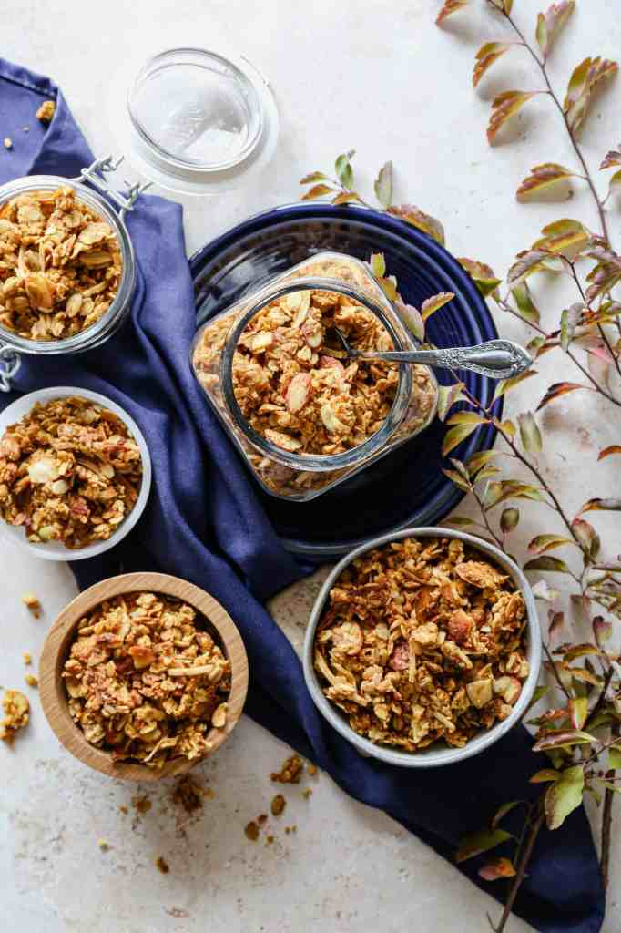 jars and bowls of gluten free pumpkin pie granola