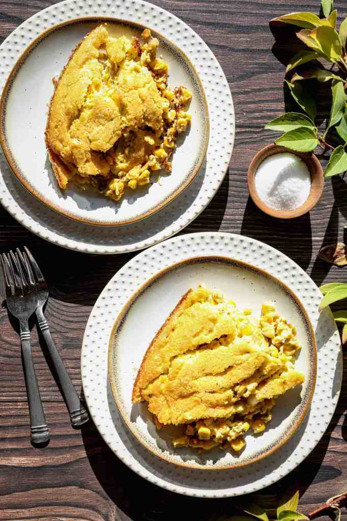 two plates of gluten free corn pudding skillet