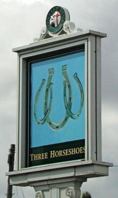 The Three Horseshoes pub sign