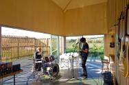 A musician's bachelor pad sits in the middle of an apple orchard. It has one bedroom and a study in 861 sq ft. | www.facebook.com/SmallHouseBliss