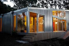 "This ""bach"" (a simple, inexpensive vacation house) for a New Zealand family has 4 bedrooms in 1,507 sq ft. Designed by architects Bonnifait + Giesen, Atelierworkshop. 