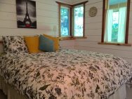 Birds' Hill Cottage is nestled in the rainforest on BC's Salt Spring Island. It has a ground-floor bedroom plus a large bedroom loft in roughly 800 sq ft. | www.facebook.com/SmallHouseBliss
