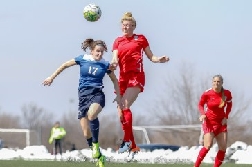 Kassey Kallman goes up against a Penn State player for the ball.