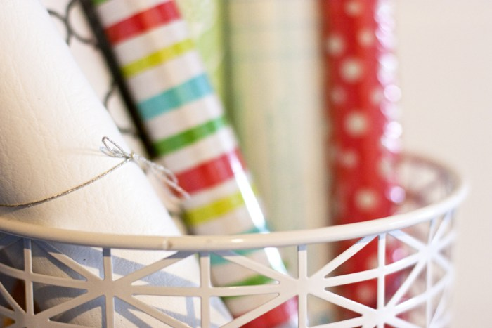 Organize wrapping paper and vinyl in a pretty basket