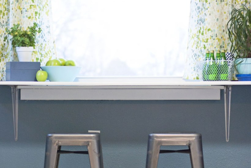 What a great way to use dead space under that window! Super cute breakfast counter for her small kitchen.