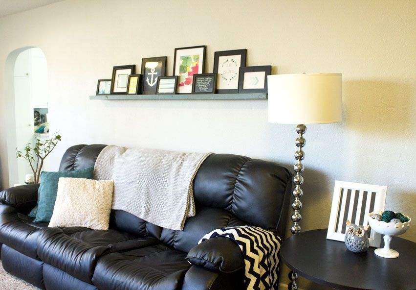 I'm loving this DIY picture ledge. And for $10? I'm seriously making one for my living room this weekend.
