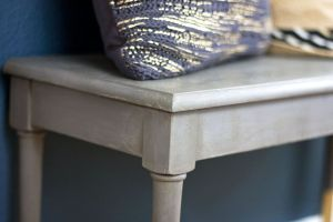 This painted piano bench is amazing. Chalk paint really makes this cheap bench look fancy.