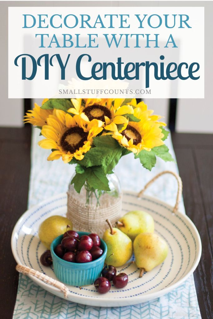 What a pretty diy centerpiece! Great decor for summer and fall. Love the sunflowers and fruit she used.