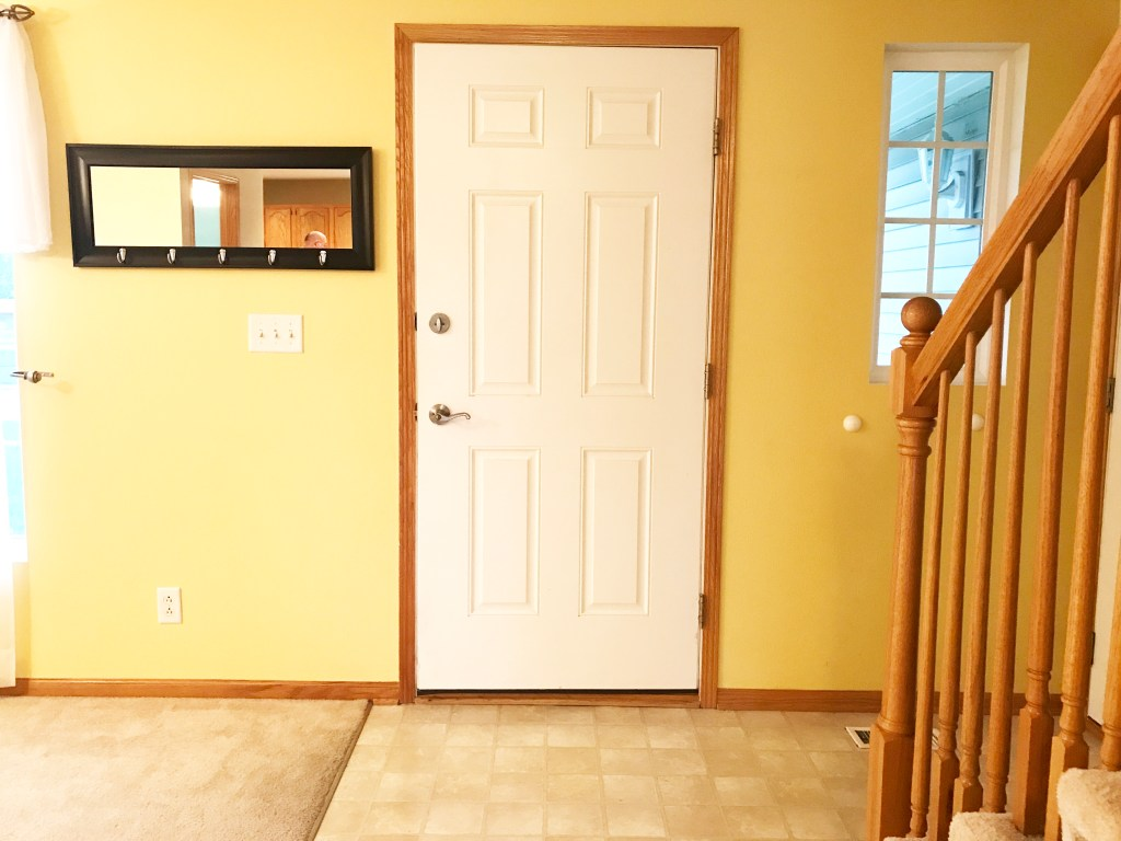 white interior front door and yellow wals