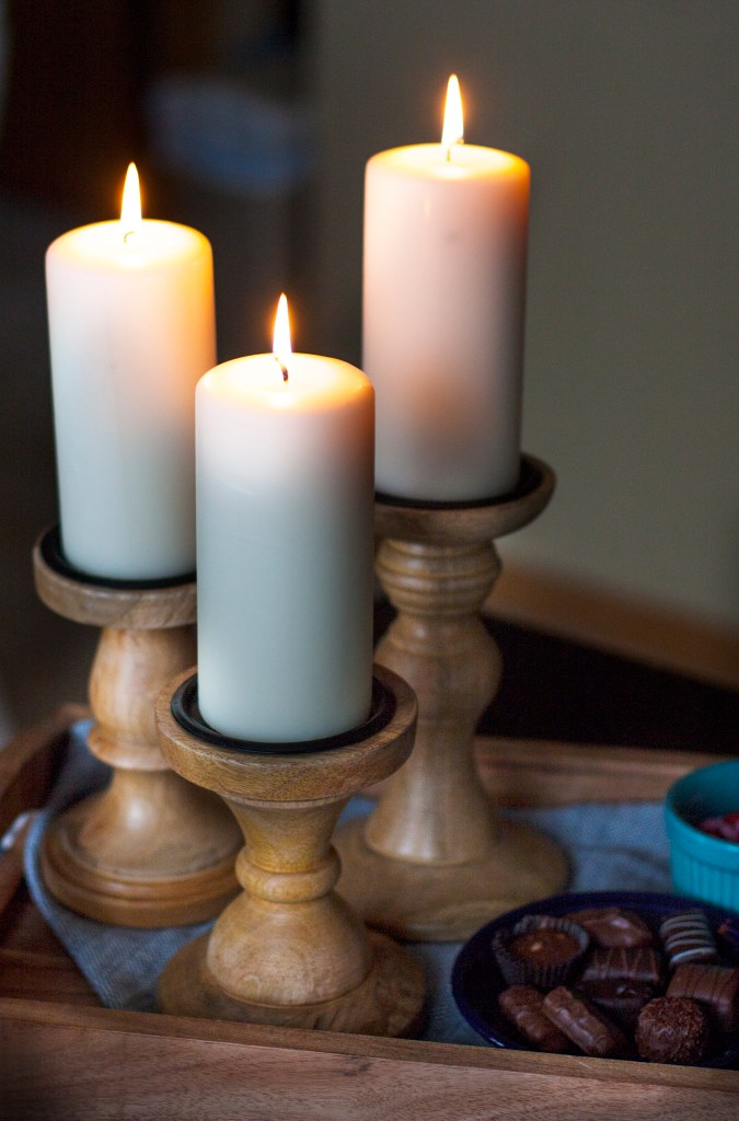 These wooden candle holders are gorgeous! I love how they are the focal point of this casual tablescape.
