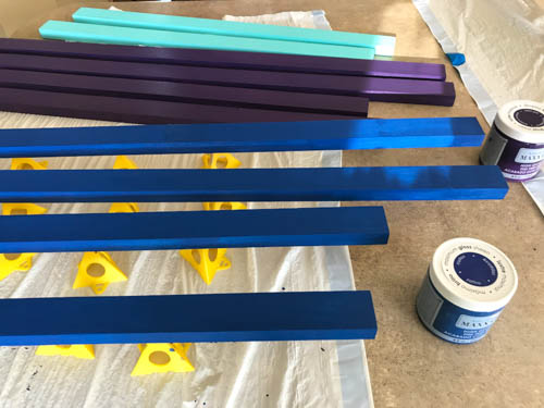 wooden-boards-painted-purple-blue-and-aqua-for-a-nursery