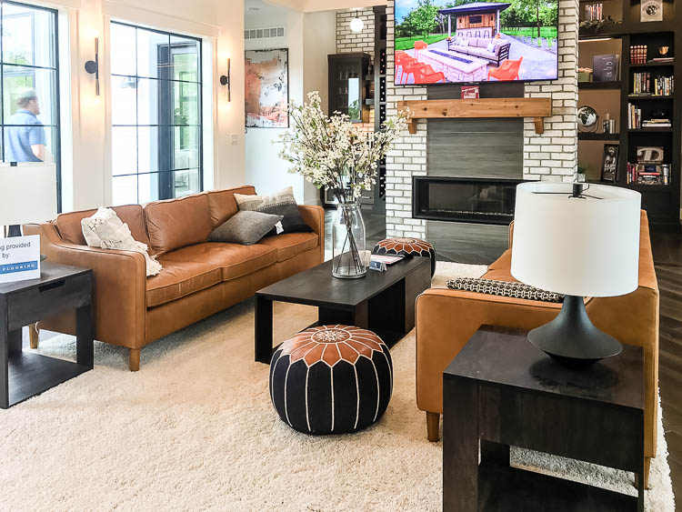 cognac-leather-sofas-by-fireplace
